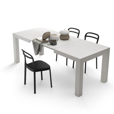 Table with 2 extensions, from 140 cm to 220 cm.
