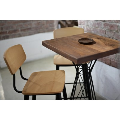 Bar table with black metal frame and walnut countertop
